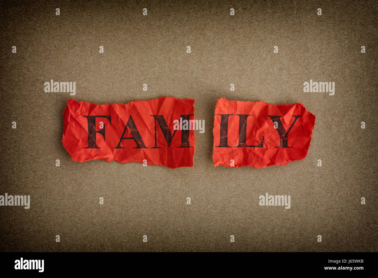 Family breakdown. Ripped piece of paper with the word Family. Concept Image. - Stock Image