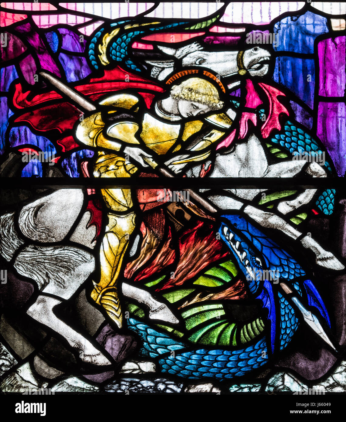 St. George slaying the dragon by Christopher Whall, St. Peter's Church, Norton on Derwent, North Yorkshire, - Stock Image