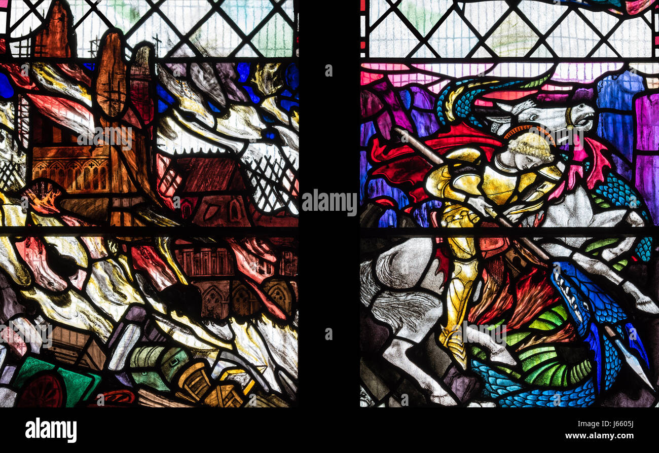 The conquest of evil depicted in the First World War memorial window by Christopher Whall, St. Peter's Church, - Stock Image