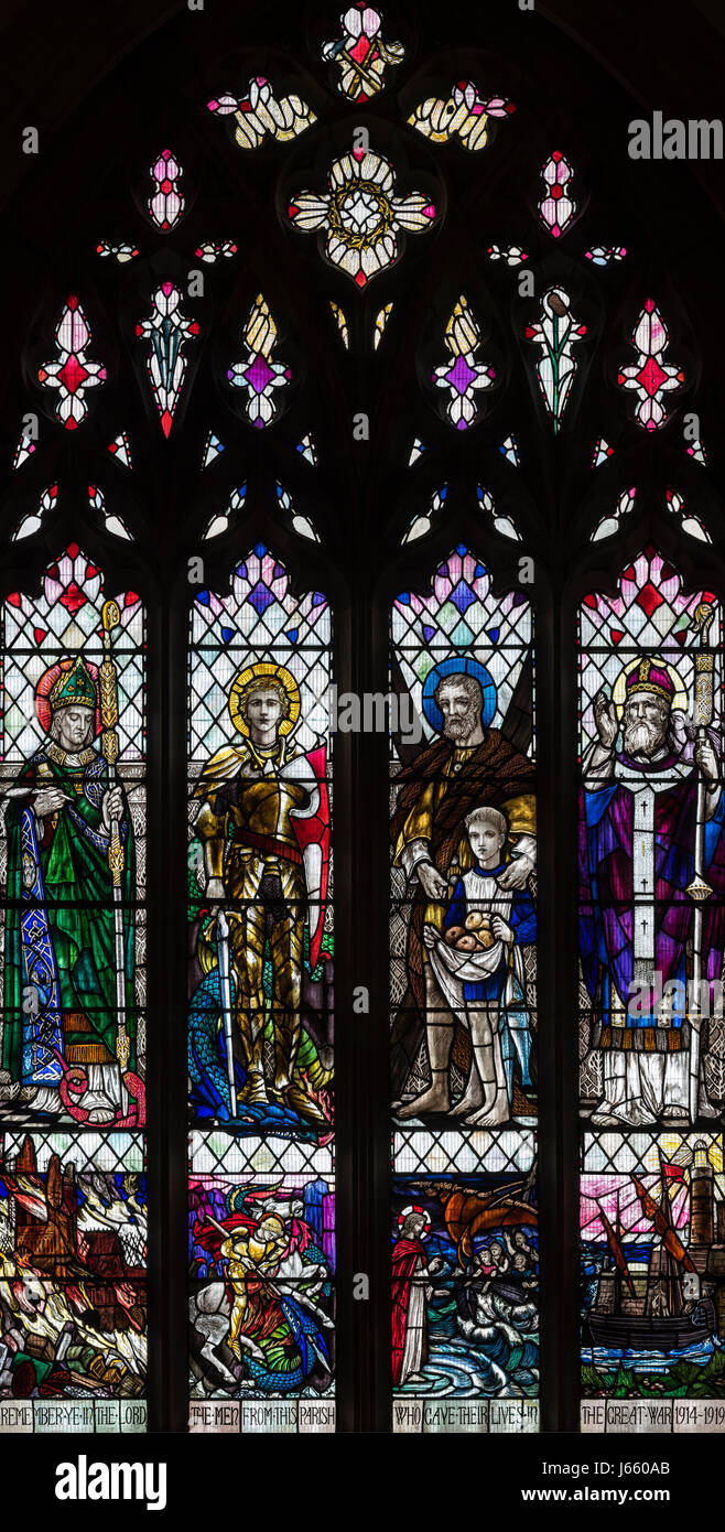 The First World War memorial window by Christopher Whall in St. Peter's Church, Norton on Derwent, North Yorkshire, - Stock Image