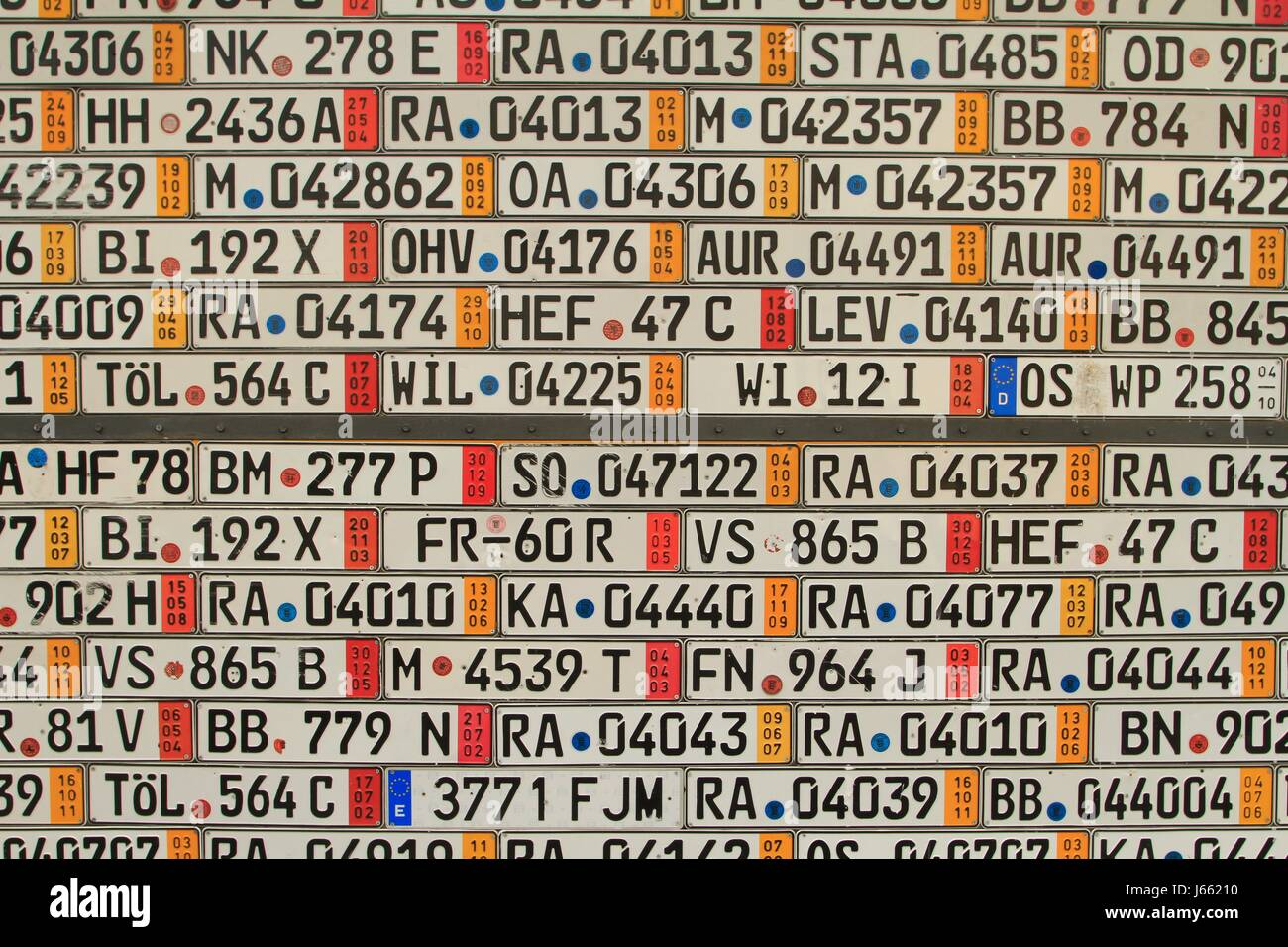 Garage door covered with European number plates - Stock Image