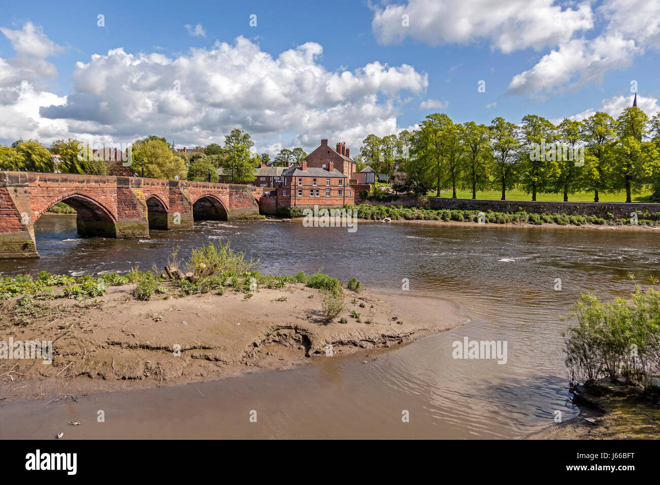 The bridge over the river Dee at Chester with Handbridge on the far bank. - Stock Image