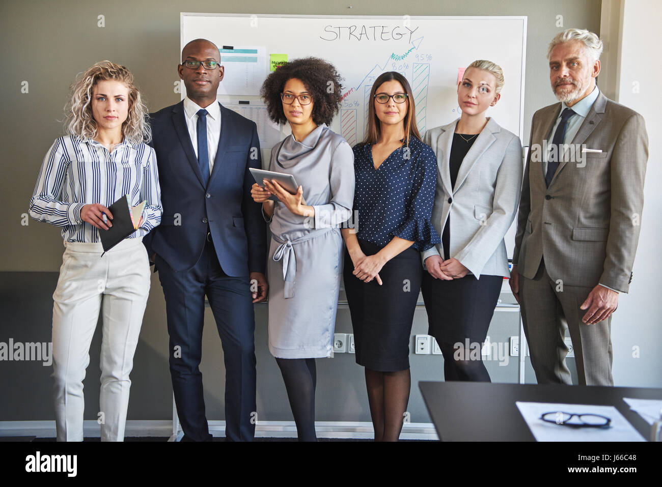 Team of business people looking at camera, mixed races entrepreneurs - Stock Image