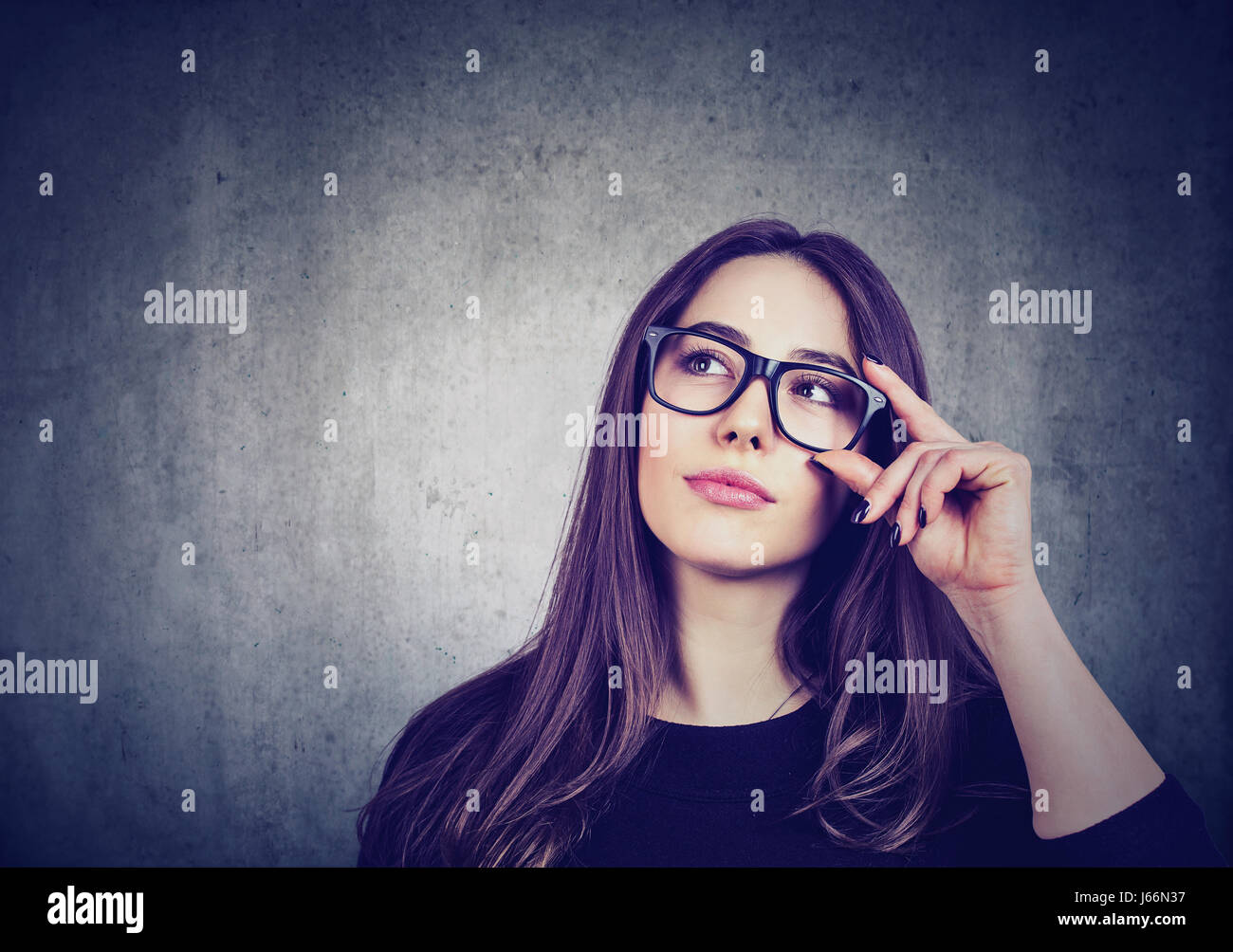Young woman thinks - Stock Image