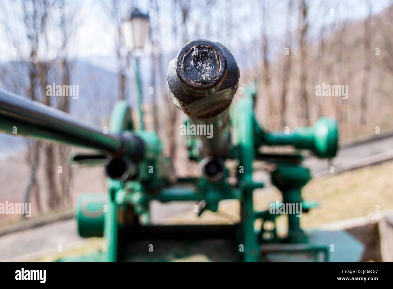 War artillery, tanks, cannons, machine guns at the position shelling, pipes directed towards the city - Stock Image