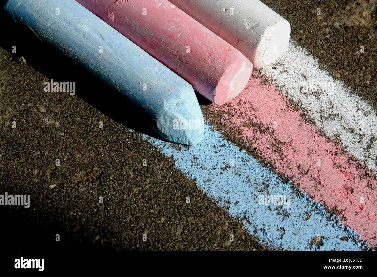 Three color chalk white,red,blue, and the pattern of stripes on the pavement. - Stock Image