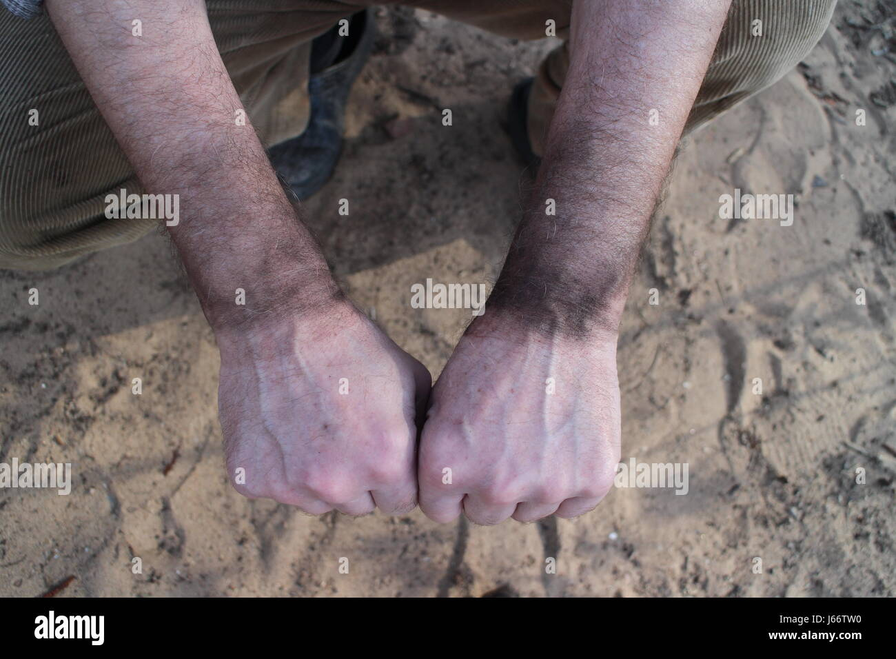 hands of the chimney-sweeper are smeared with soot - Stock Image