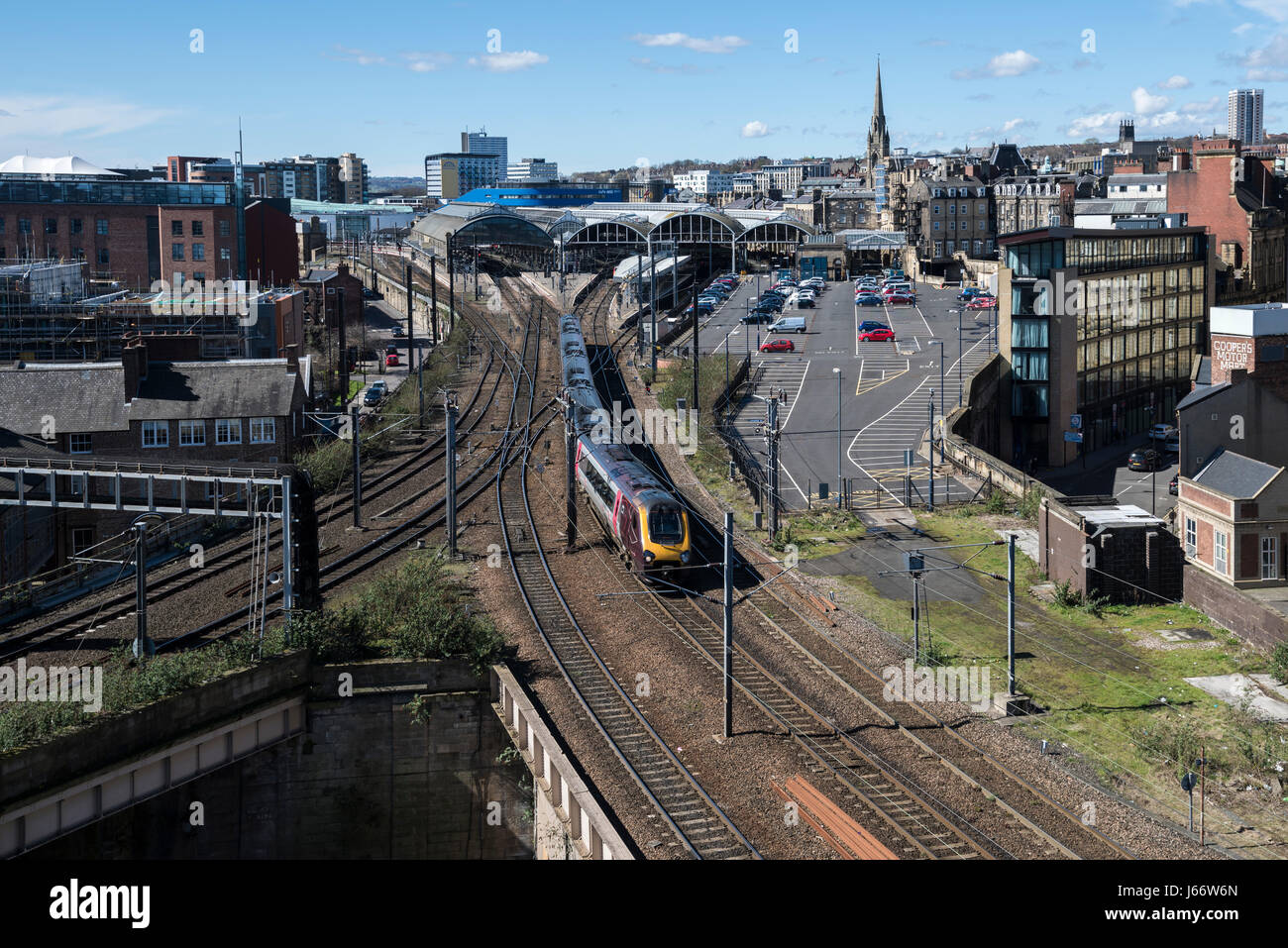 TransPennine Express train heading north bound on departure from Newcastle upon Tyne Central Station, England. - Stock Image