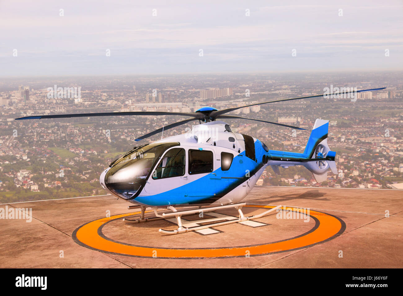 helicopter parking on building roof top use for commercial