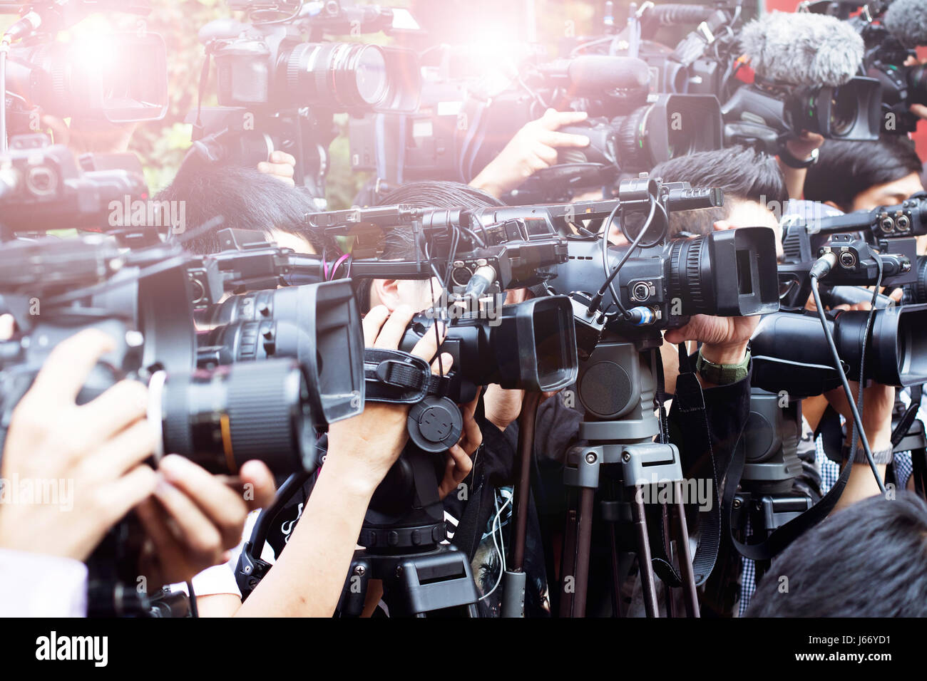 press and media camera ,video photographer on duty in public news event for reporter - Stock Image