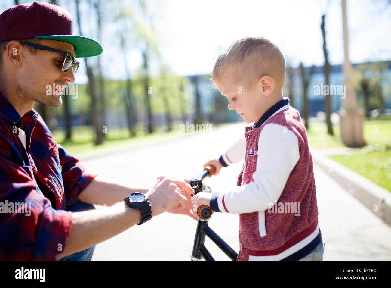 Dad ,son on bike ride - Stock Image