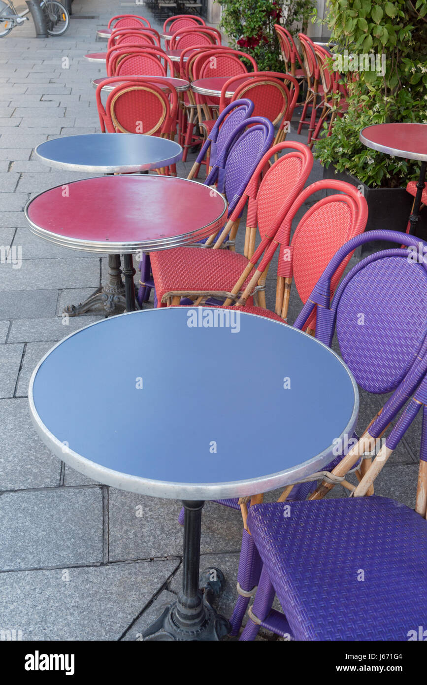 Colored tables and chairs on a sidewalk cafe in Paris -France Stock Photo