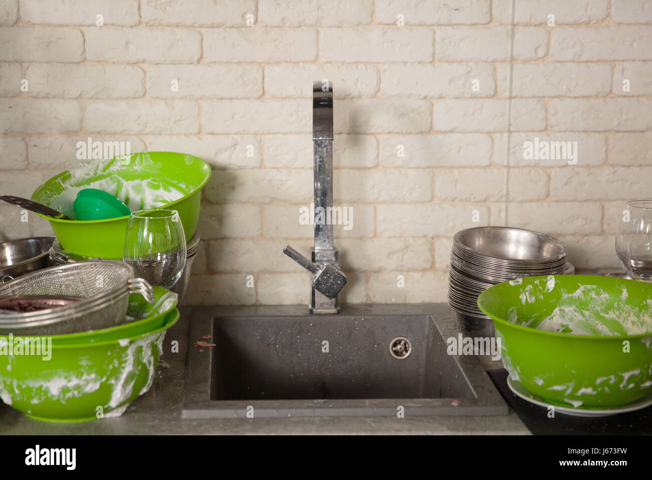 Kitchen utensils need a wash - Stock Image