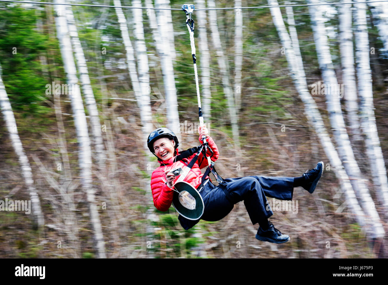 Mackinaw City Michigan Mackinac State Historic Parks Park Historic Mill Creek Discovery Park zip line safety harness - Stock Image