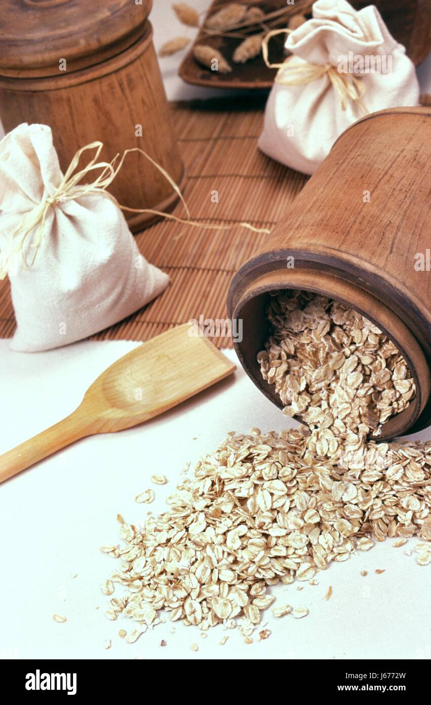 oats cereal flake hairline crack oatmeal oat flakes grain food aliment tool - Stock Image