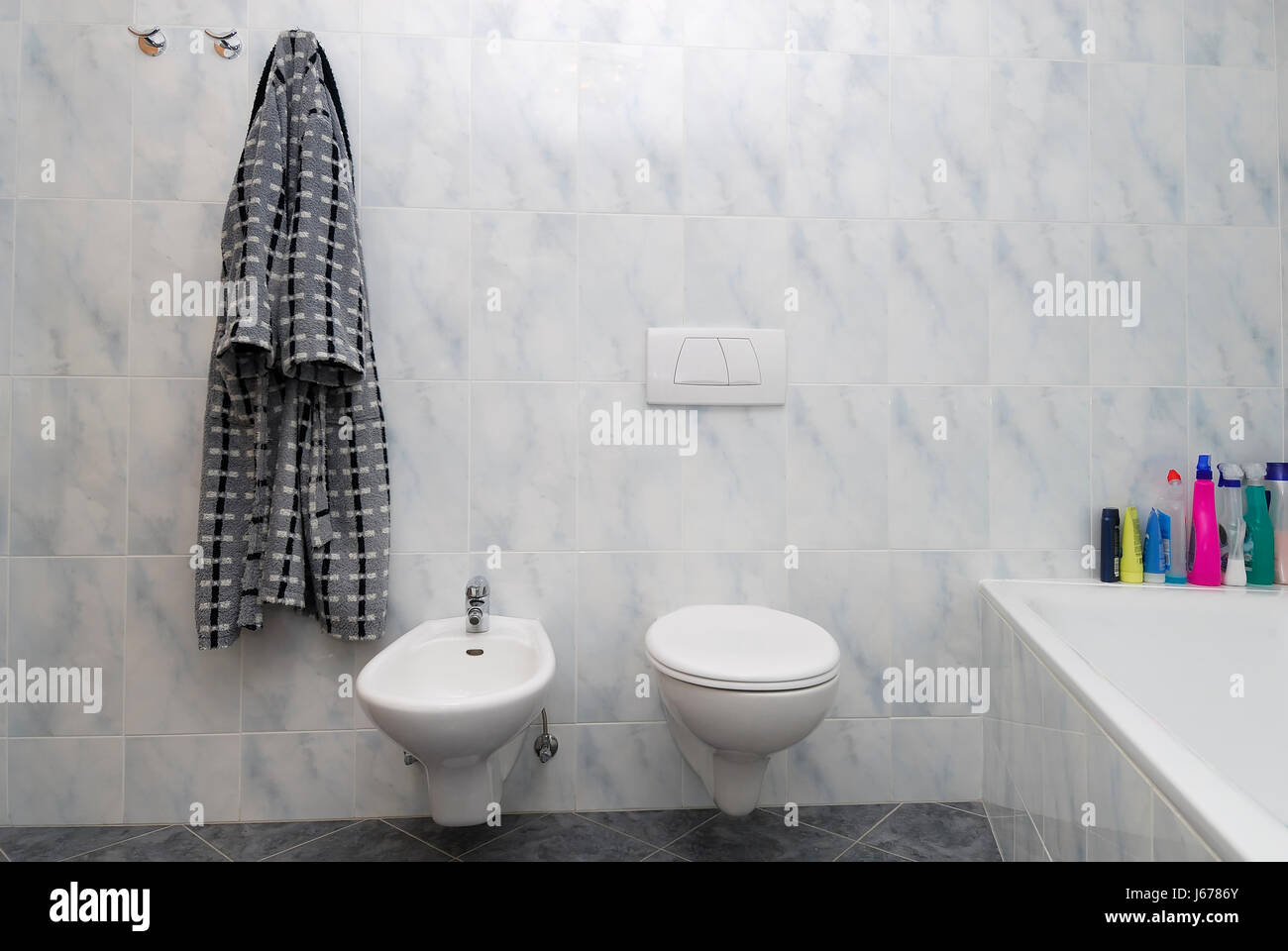 flow ceramic tiles toilet washroom bidet bathroom flow ceramic tiles bathrobe Stock Photo