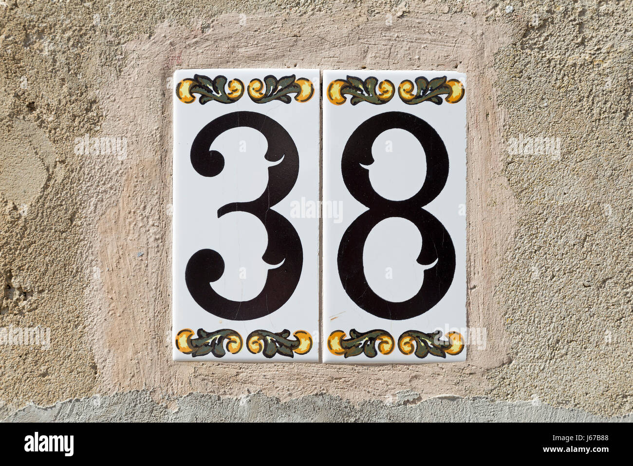 tiles with house number in Pollenca, Majorca, Spain - Stock Image