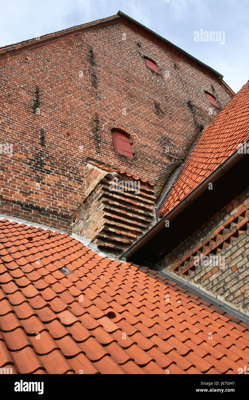 stone wall crannies flap metal fittings rooftop blue wood brick opening Stock Photo