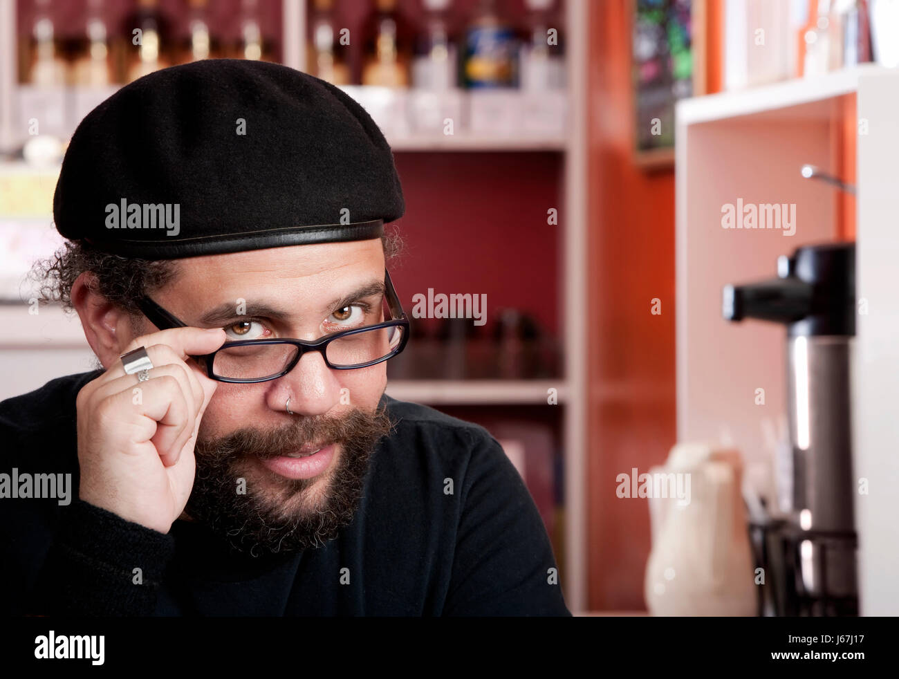 37ed25228928f male masculine adult beard handsome adults beret goatee man cafe restaurant  - Stock Image