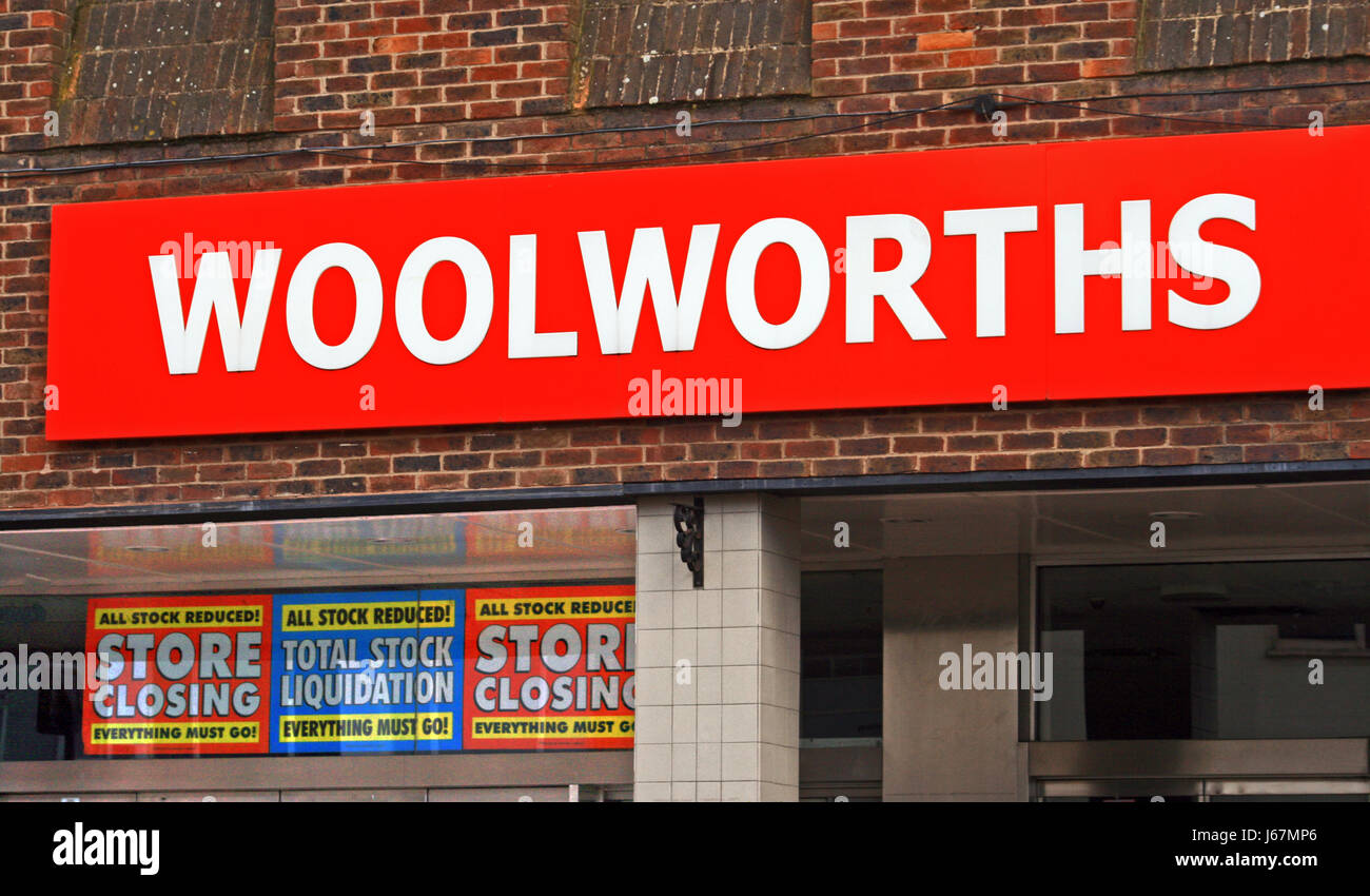 High street shop Woolworths , with store closing down and stock  liquidation sale sign in their  window prior to - Stock Image