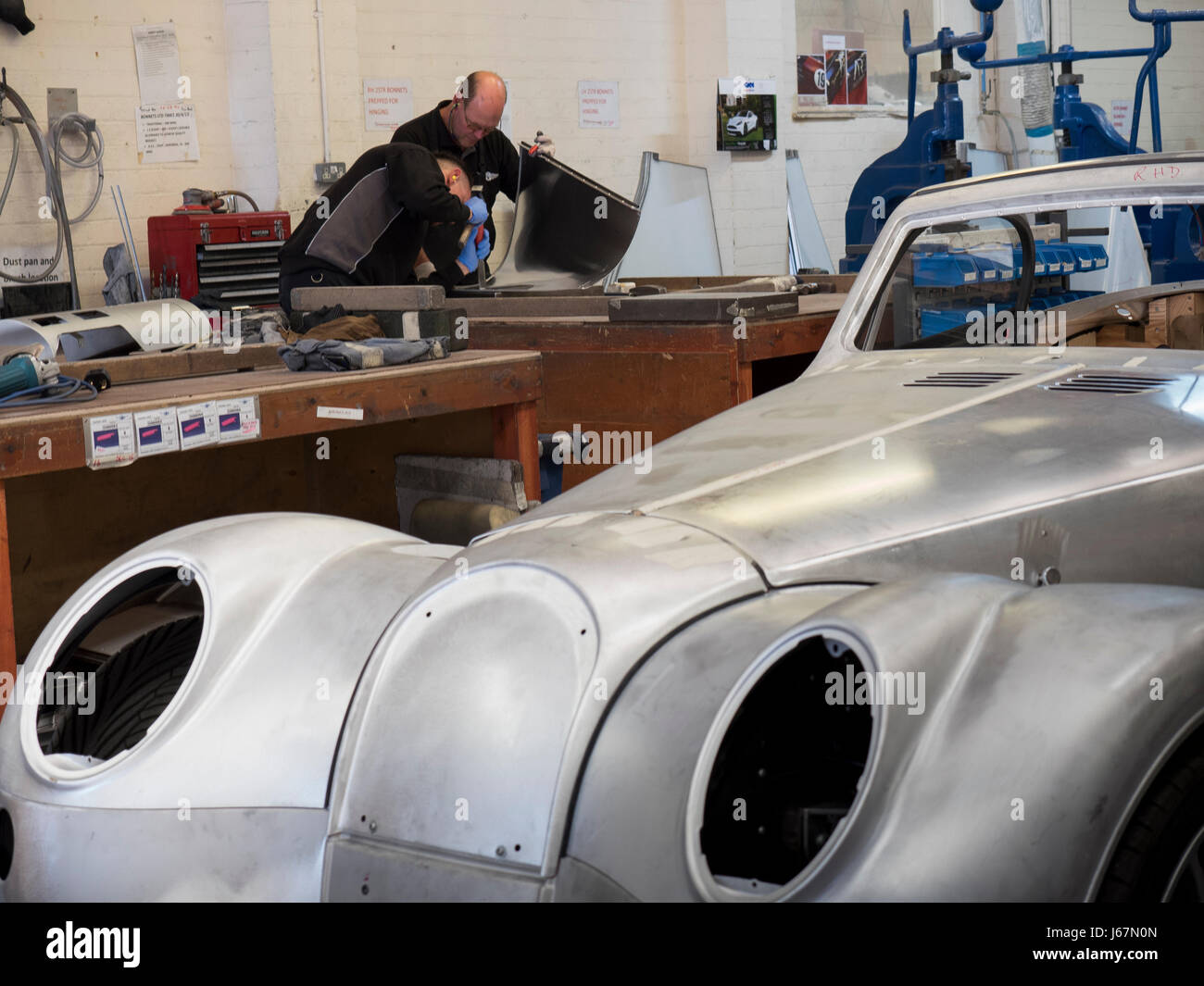 Morgan sports cars parked in the employee parking lot at the Malvern, England Morgan Motor Co. factory. - Stock Image