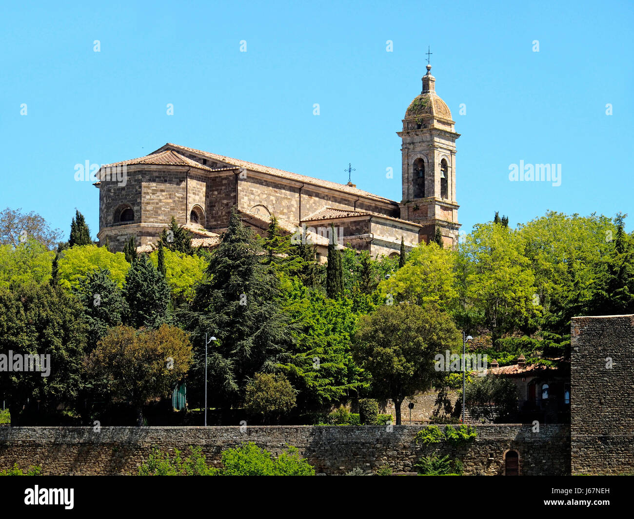 San Salvatore Roman Catholic Cathedral within the stone walls of the Tuscan hilltop town of Montalcino, Italy. - Stock Image