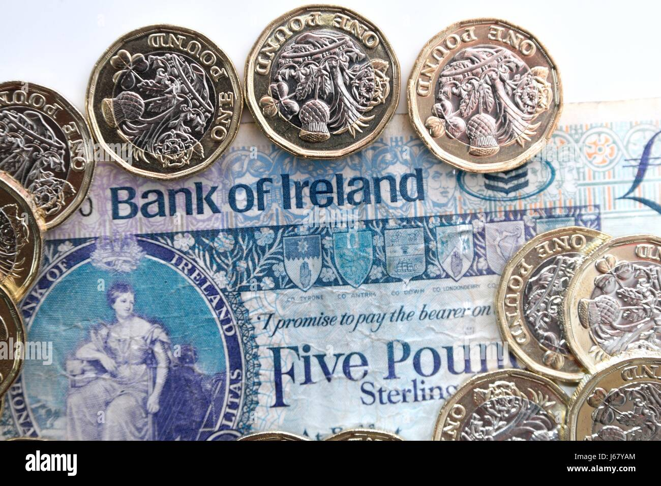 New pound coins and bank of Ireland note - Stock Image