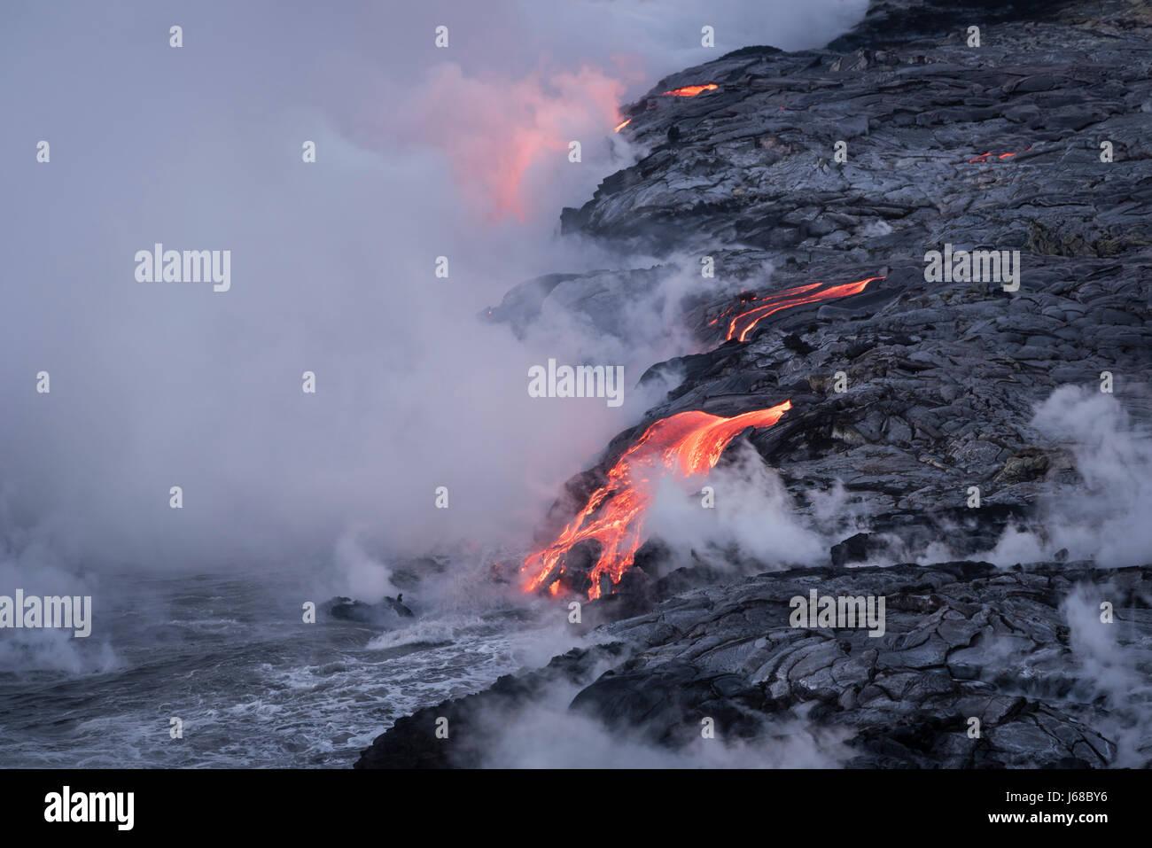 Lava from Pu'u O'o eruption entering the ocean; Hawaii Volcanoes National Park, Island of Hawaii. - Stock Image