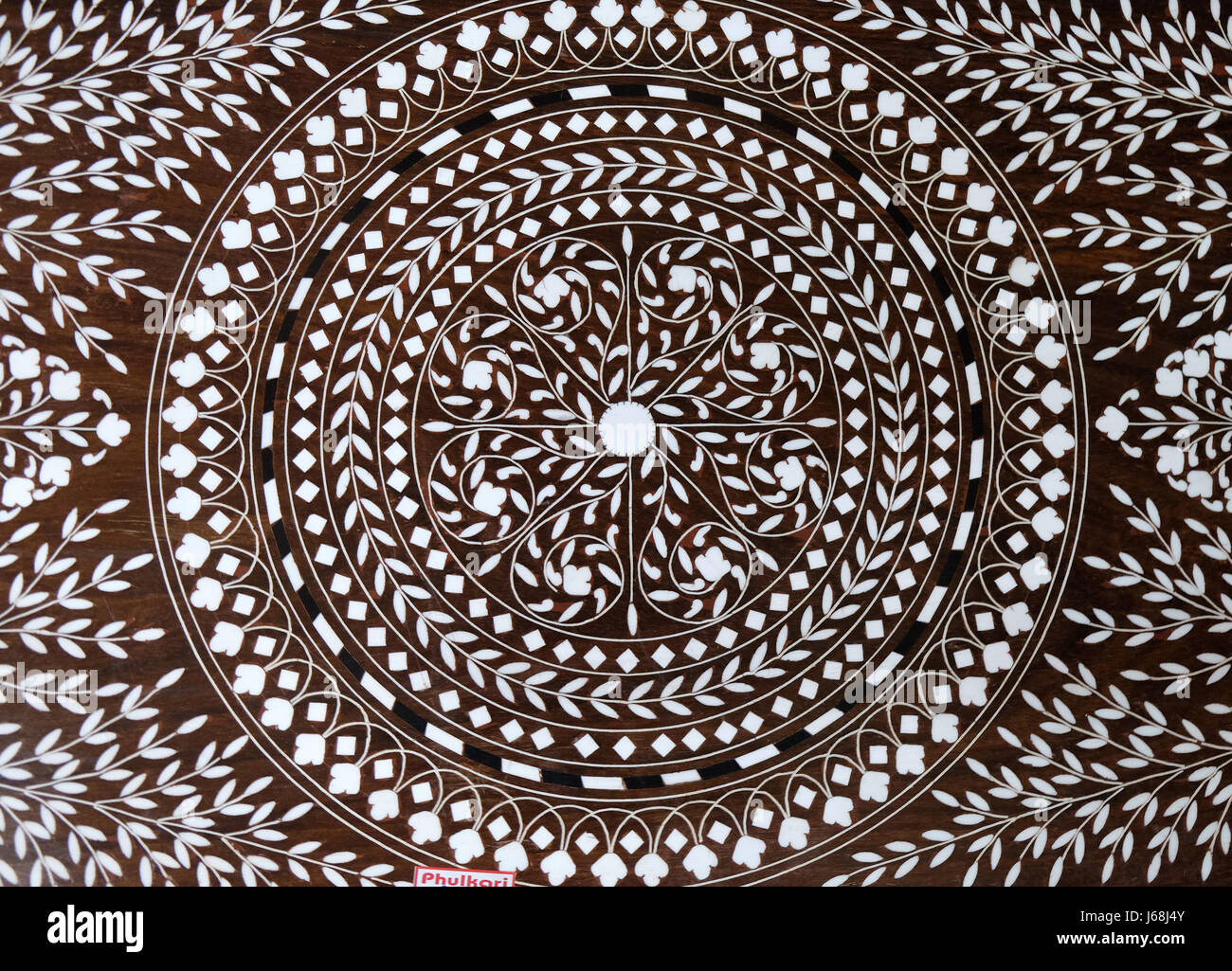 Indian marquetry panel with circular and floral pattern, part of a table, souvenir shop in Kolkata, India - Stock Image