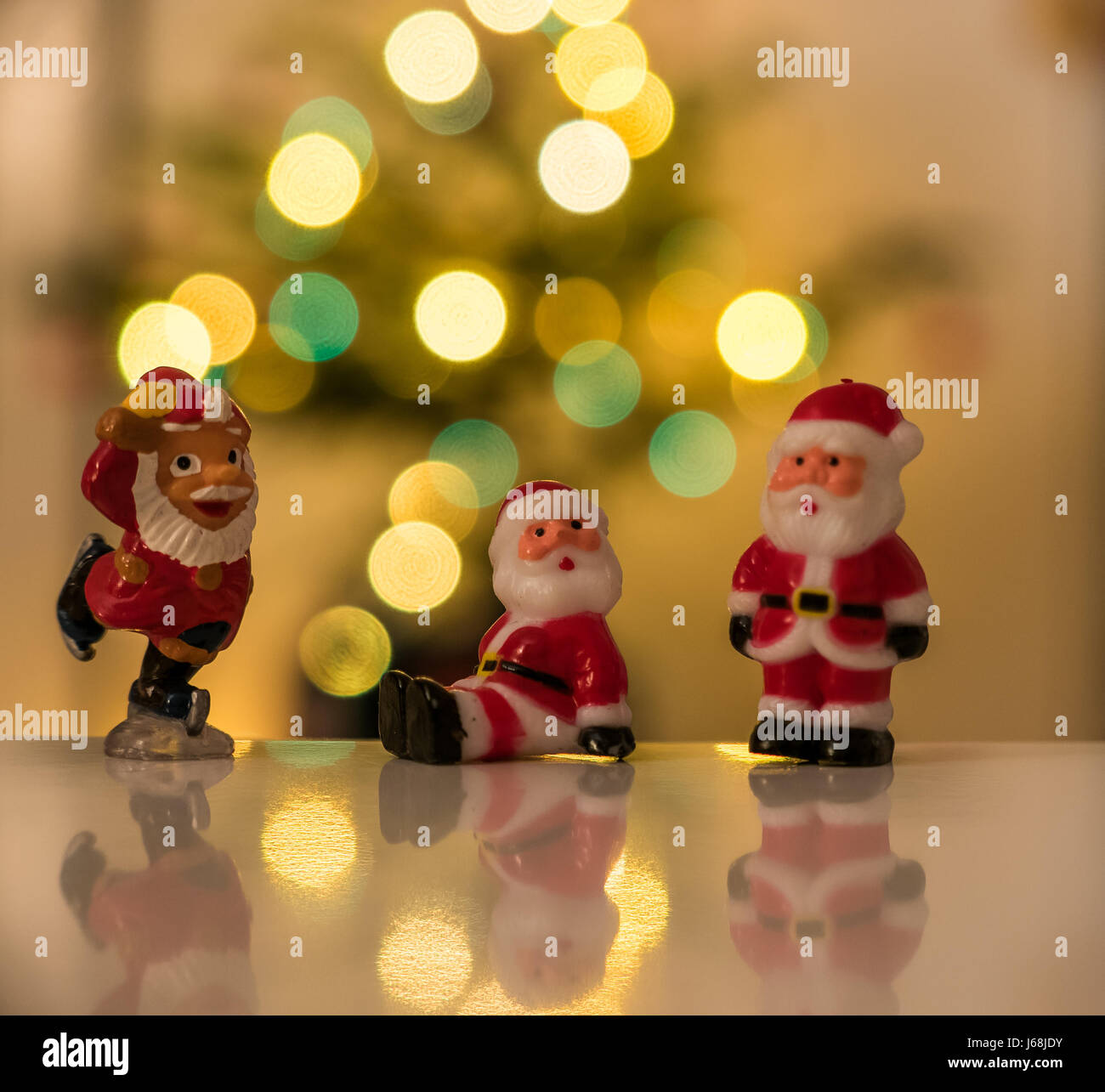 Fun Father Christmas figurines on white surface with Christmas ...