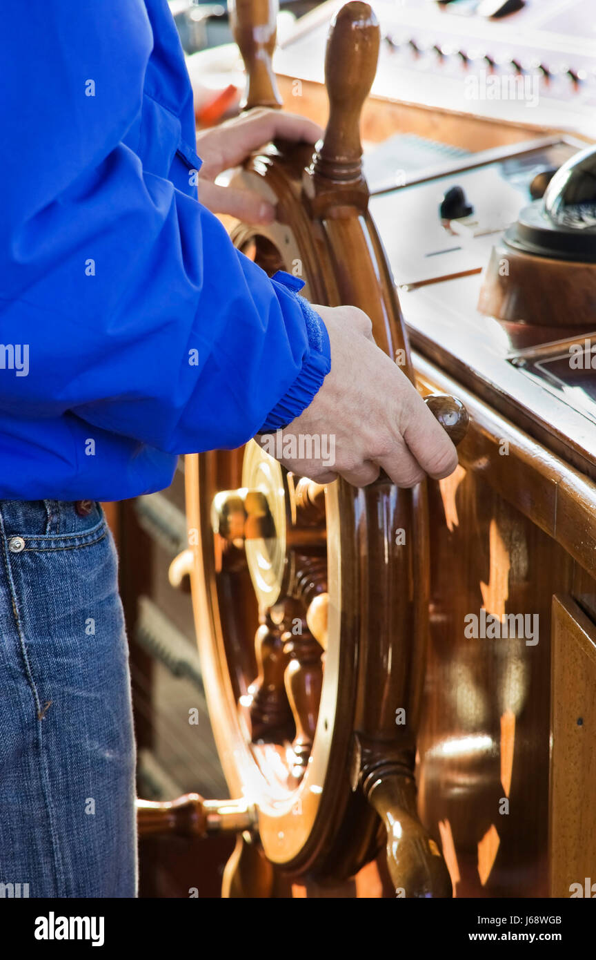 wheel leader captain chieftain chief boss manager superior boat navigate rowing Stock Photo