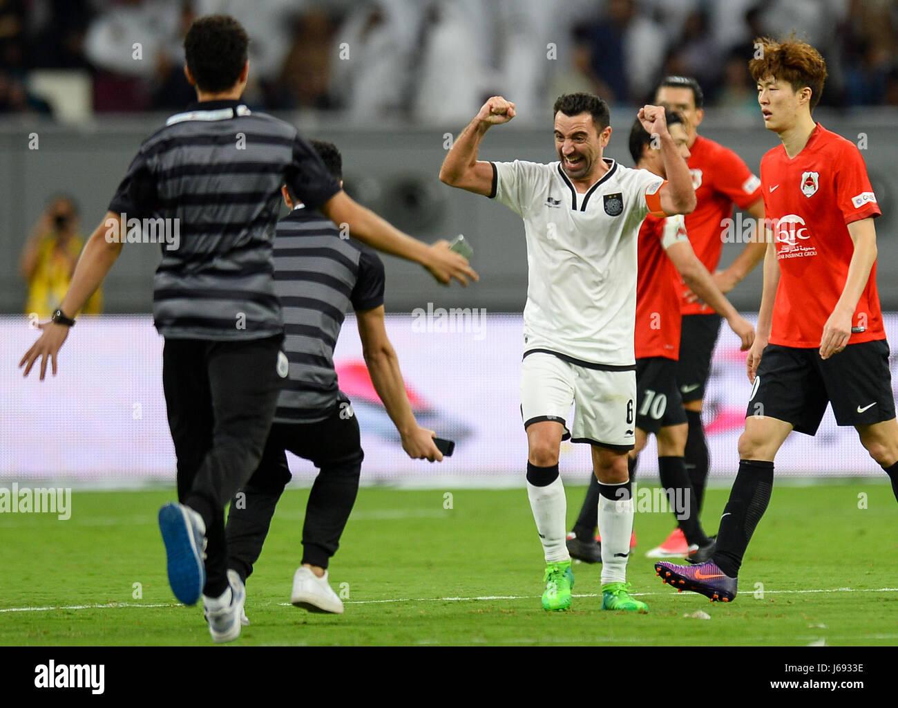 Doha, Qatar. 19th May, 2017. Xavi (3rd, L) of Al-Sadd celebrates with his teammates after winning the Qatar Emir Stock Photo