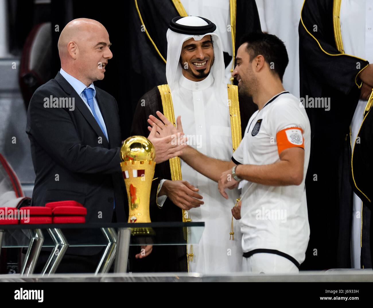 Doha, Qatar. 19th May, 2017. FIFA President Gianni Infantino (L) congratulates Xavi (R) of Al-Sadd during the awarding Stock Photo