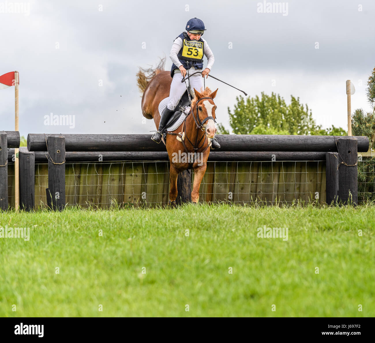 Rockingham Castle grounds, Corby, England. Saturday 20th May 2017. Boo Guest and her horse Nanteglwys Brynmor leap Stock Photo