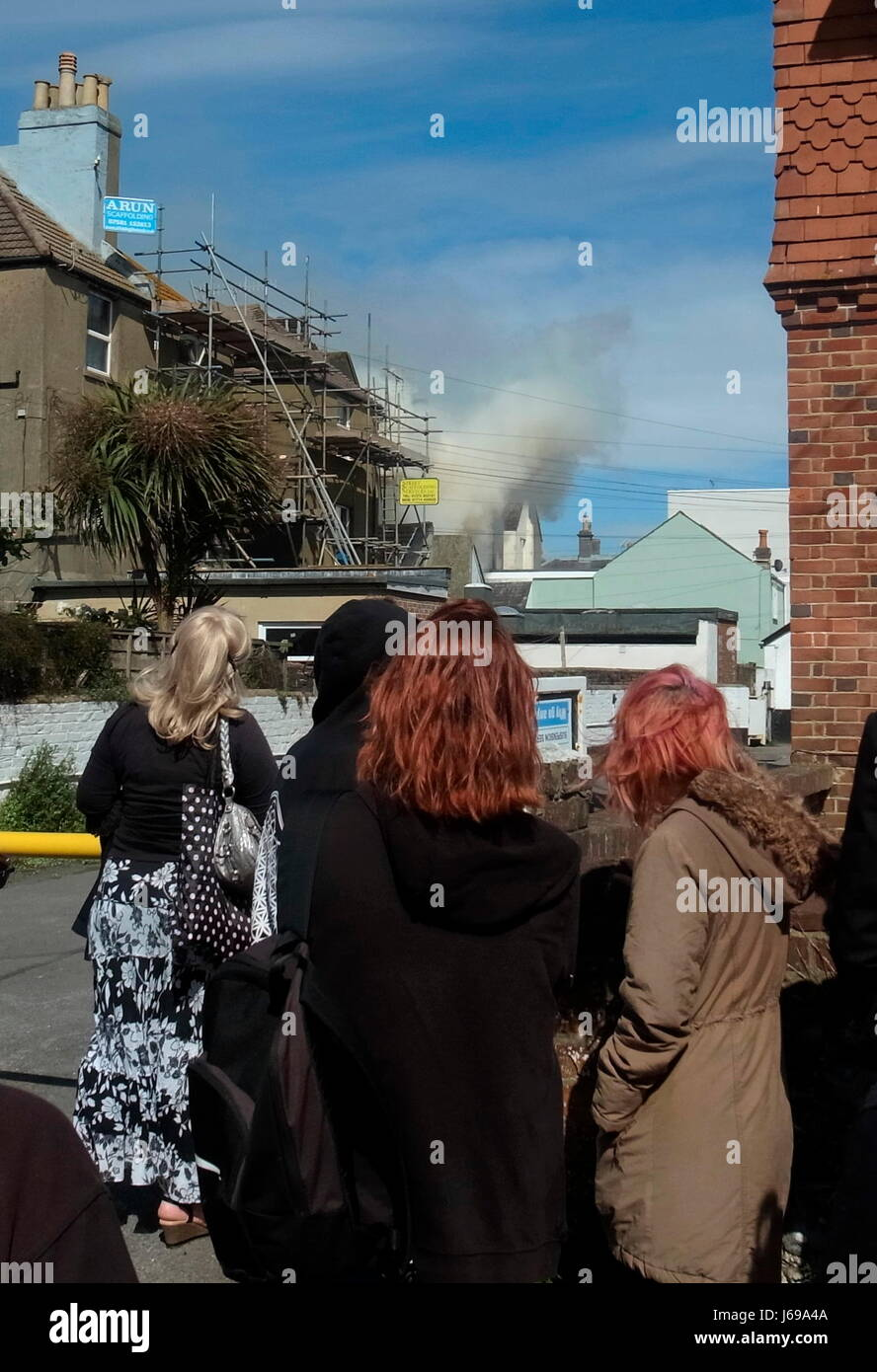 Worthing, England. 20th May, 2017. - Firemen tackle flat fire - Spectators watch West Sussex Fire & Rescue Service - Stock Image
