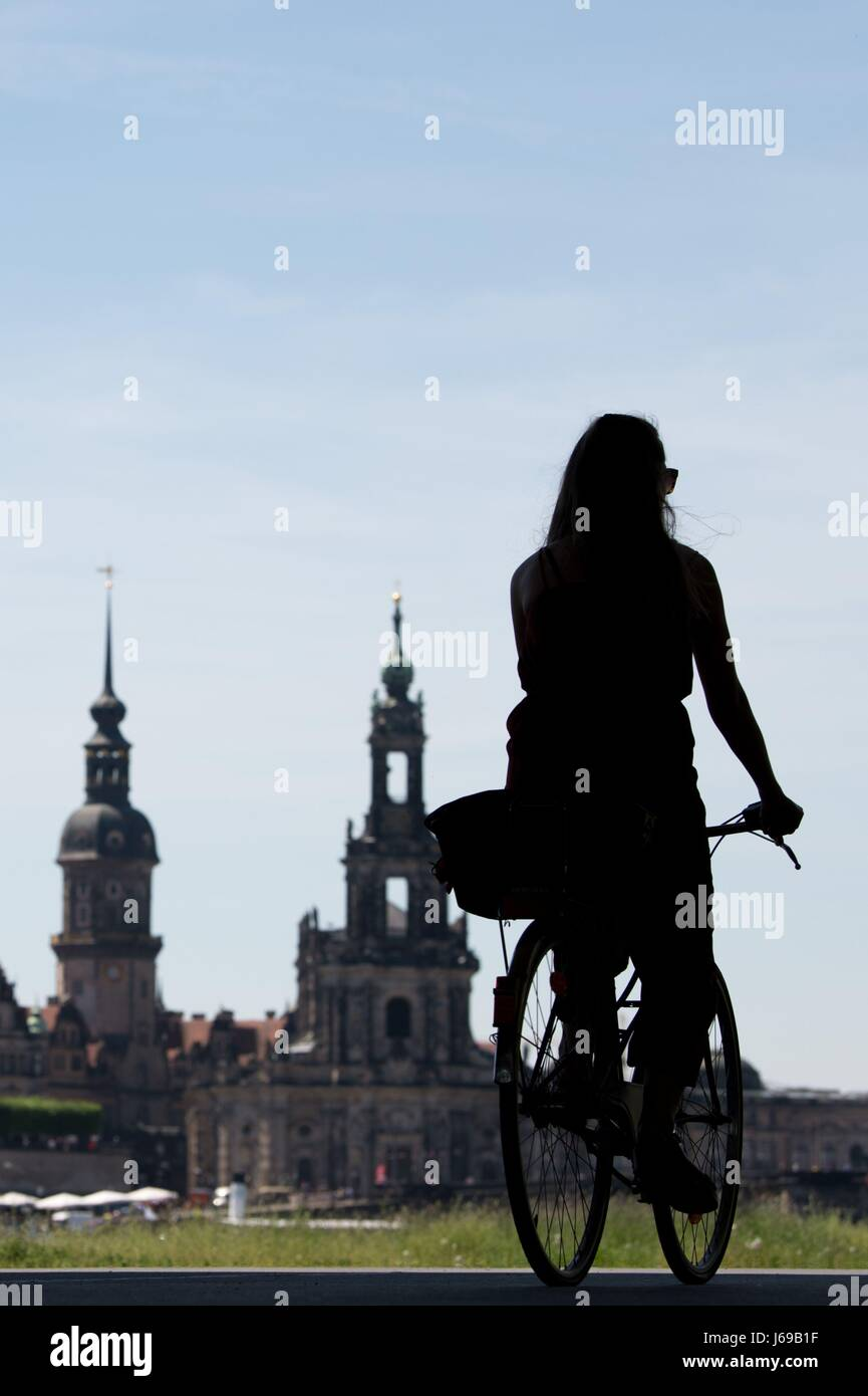 Dresden, Germany. 18th May, 2017. The outline of a cyclist seen in front of the Hausmannsturm tower (C) and the - Stock Image