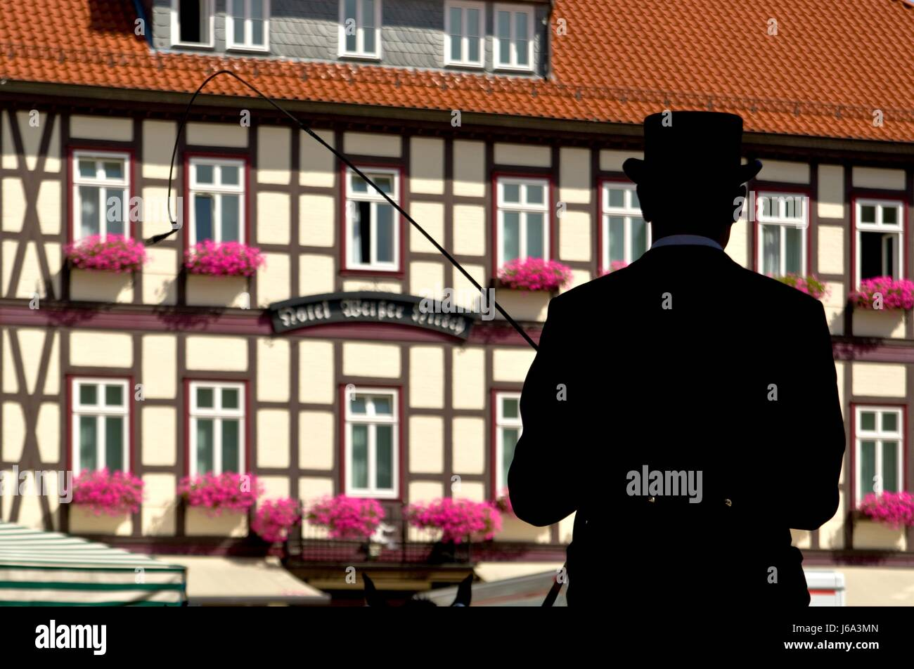 kutscher silhouette in front of half-timbered house Stock Photo