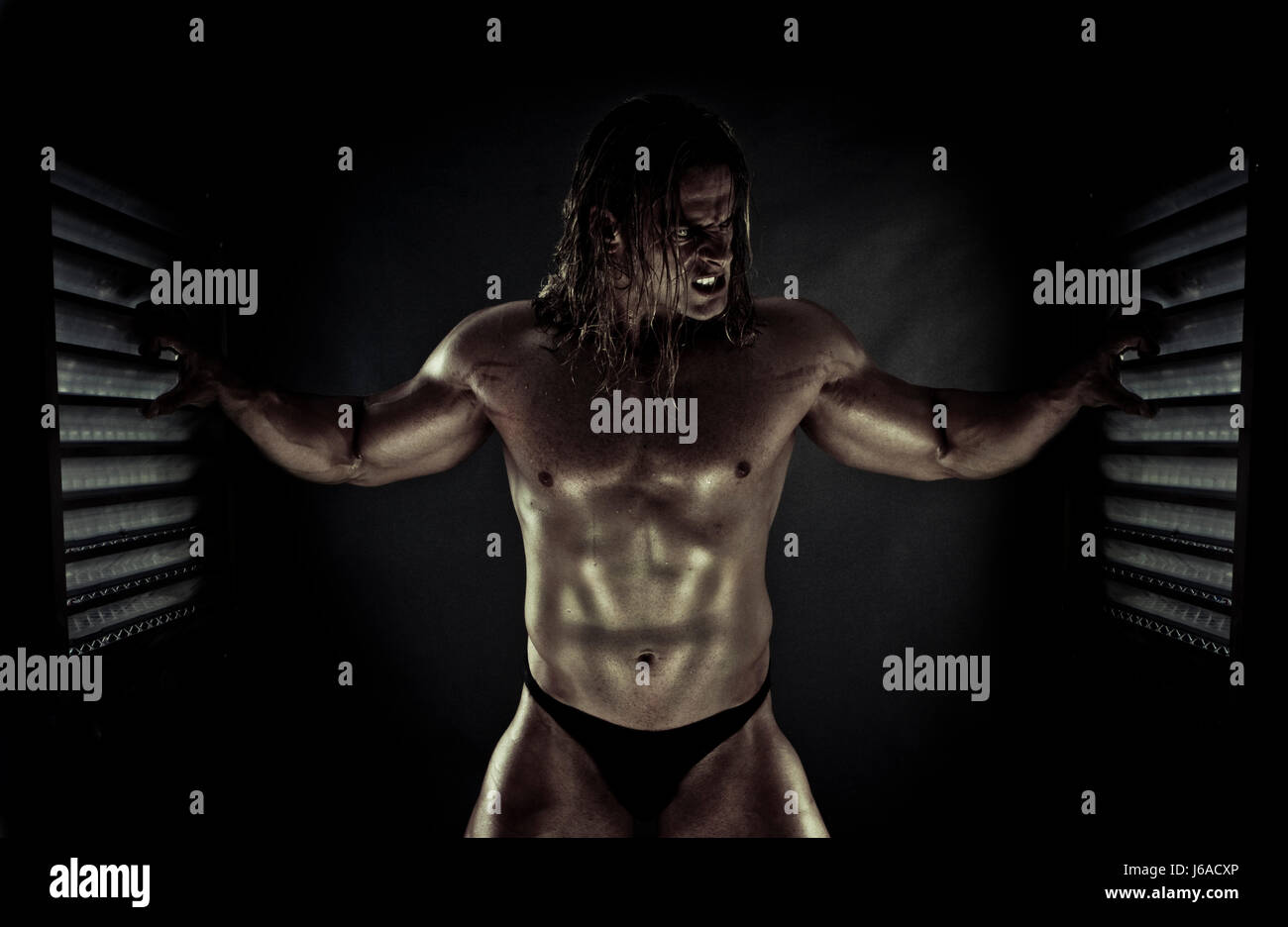 adult bad peccant wickedly evil bodybuilding raving furious angry irately - Stock Image