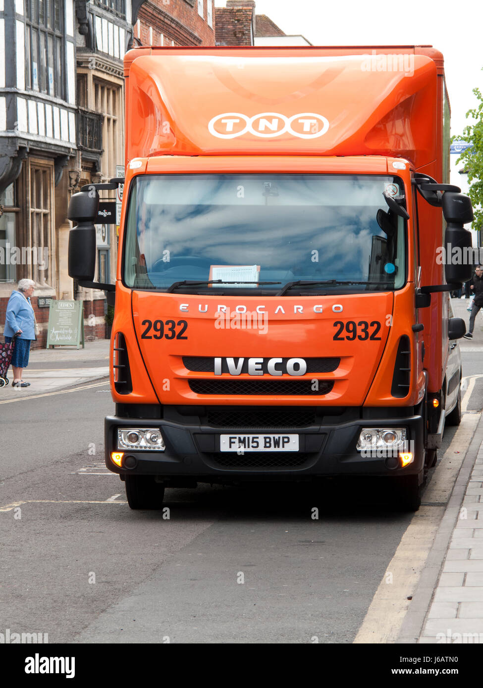 654a3bdc5c307a TNT Express lorry parked in street making delivery or collection