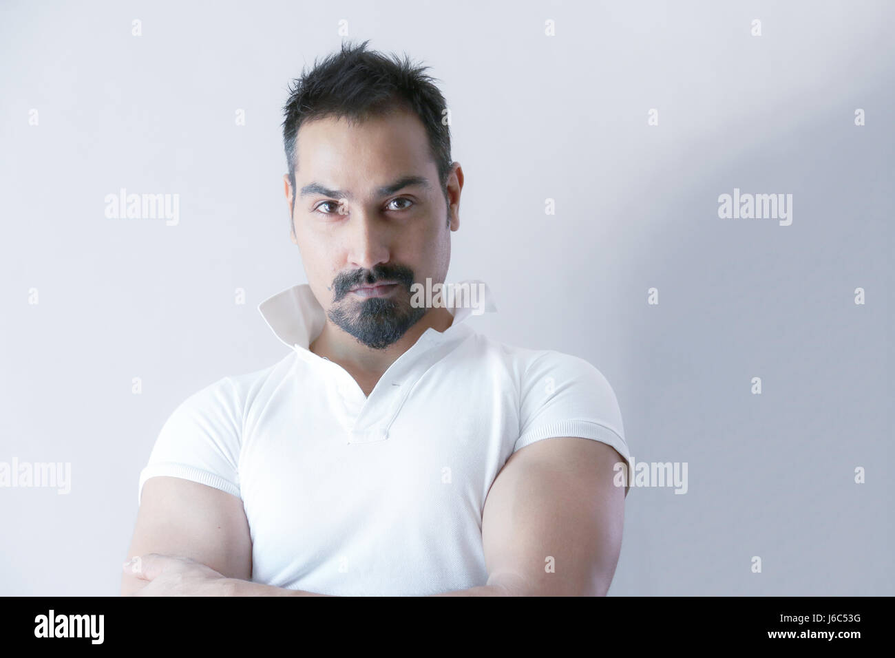 Male Model Short Hair Beard White T Shirt And White Background Stock Photo Alamy