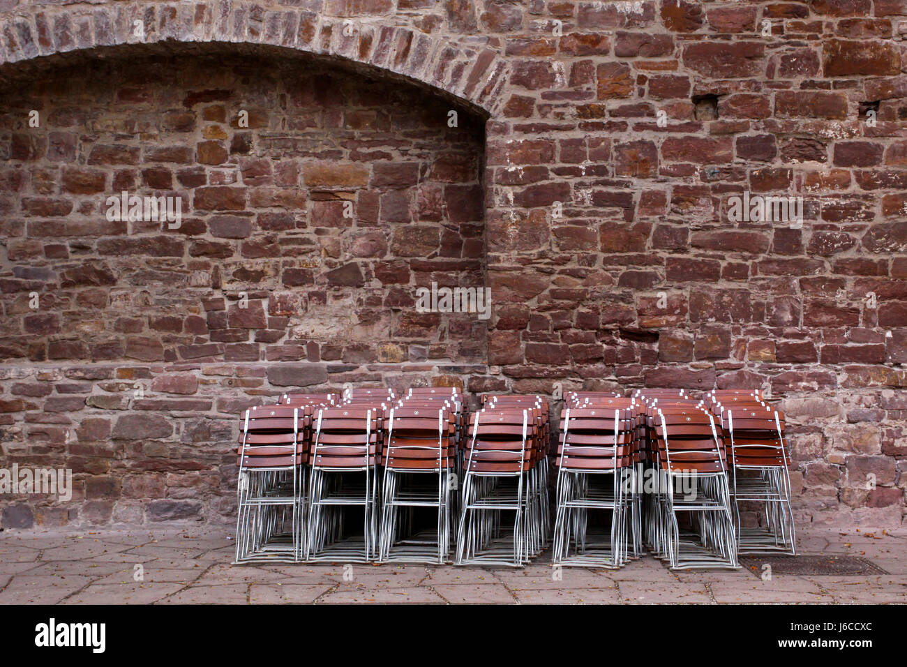 brown brownish brunette chairs space saving folded up chair furniture brown Stock Photo