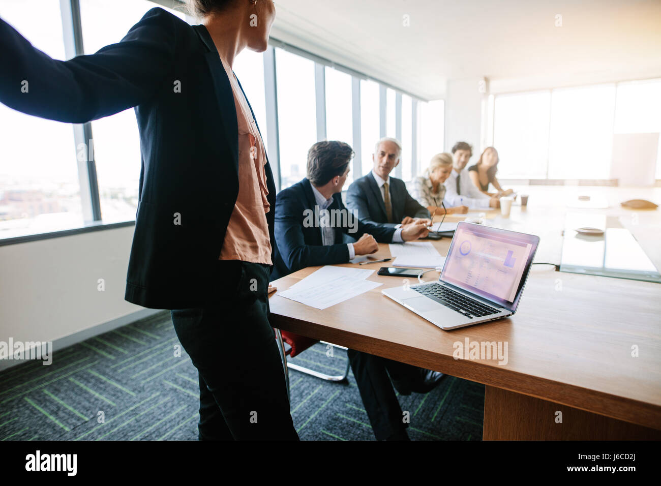 Corporate professionals have meeting in conference room and discussing about new business plans. Business associates - Stock Image