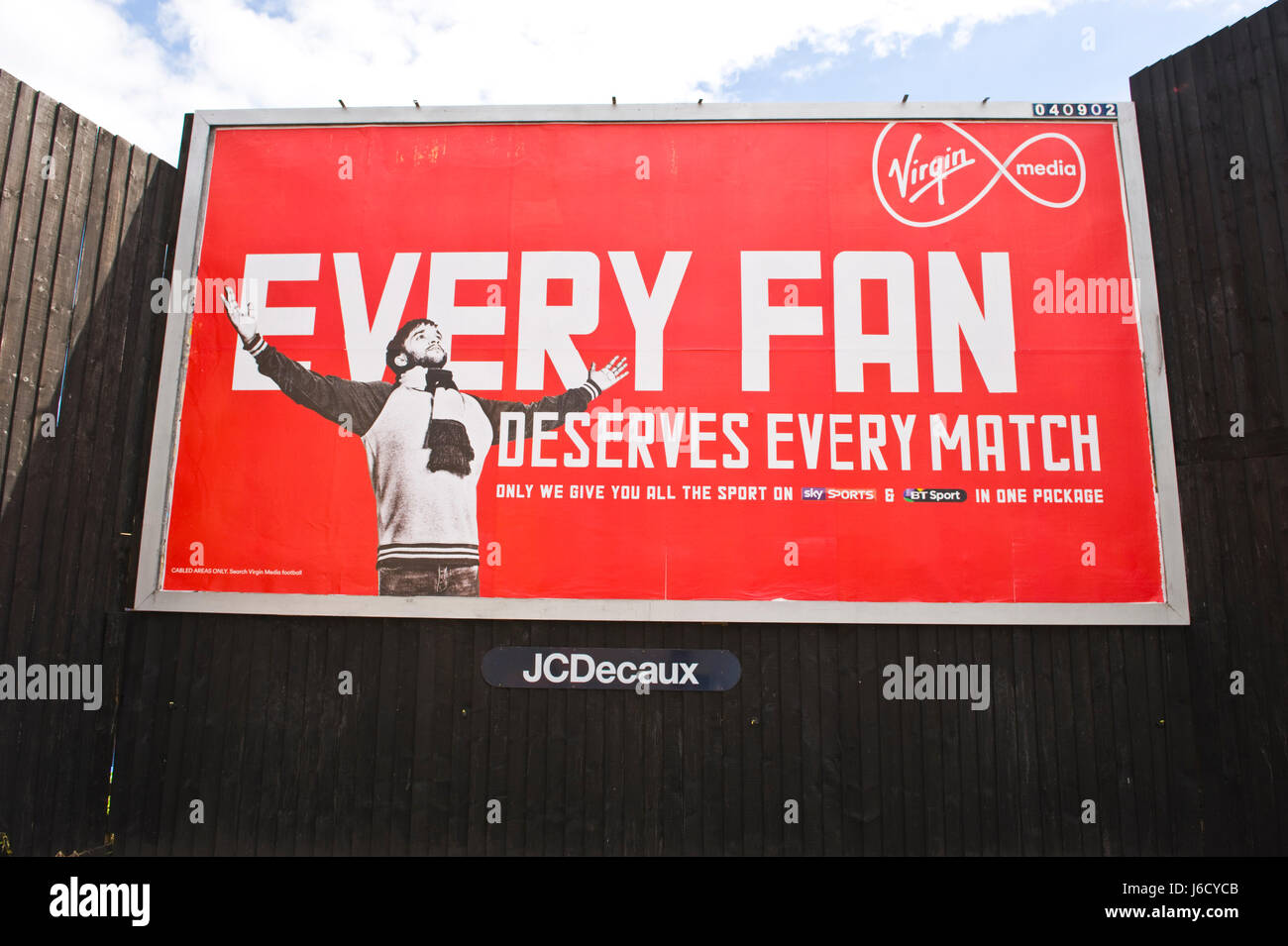 Virgin Media football for fans package 48 sheet advertising billboard on JCDecaux site in Newport, South Wales, - Stock Image