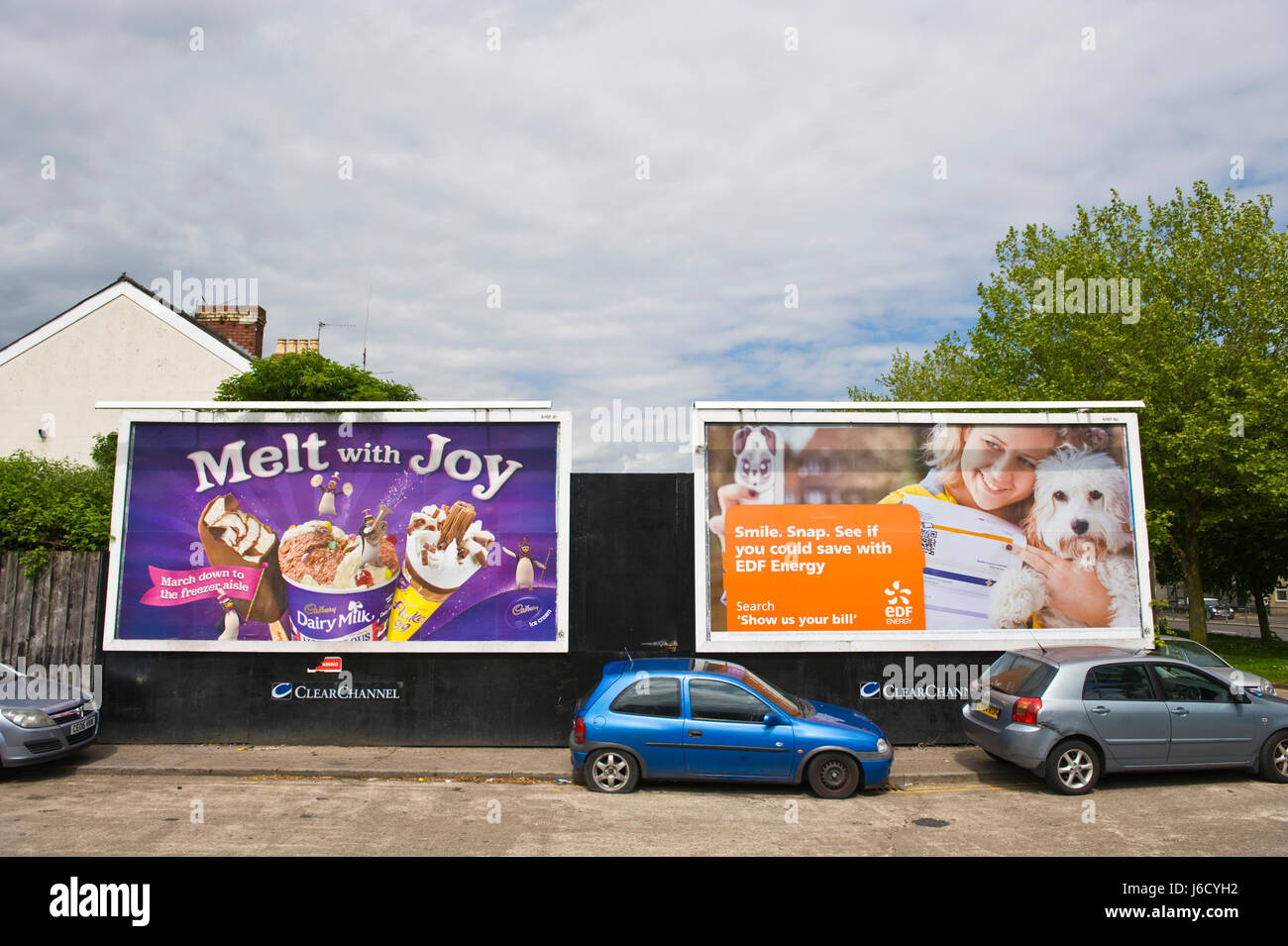 Cadbury's ice cream & EDF Energy 48 sheet advertising billboards on ClearChannel site in Newport, South - Stock Image