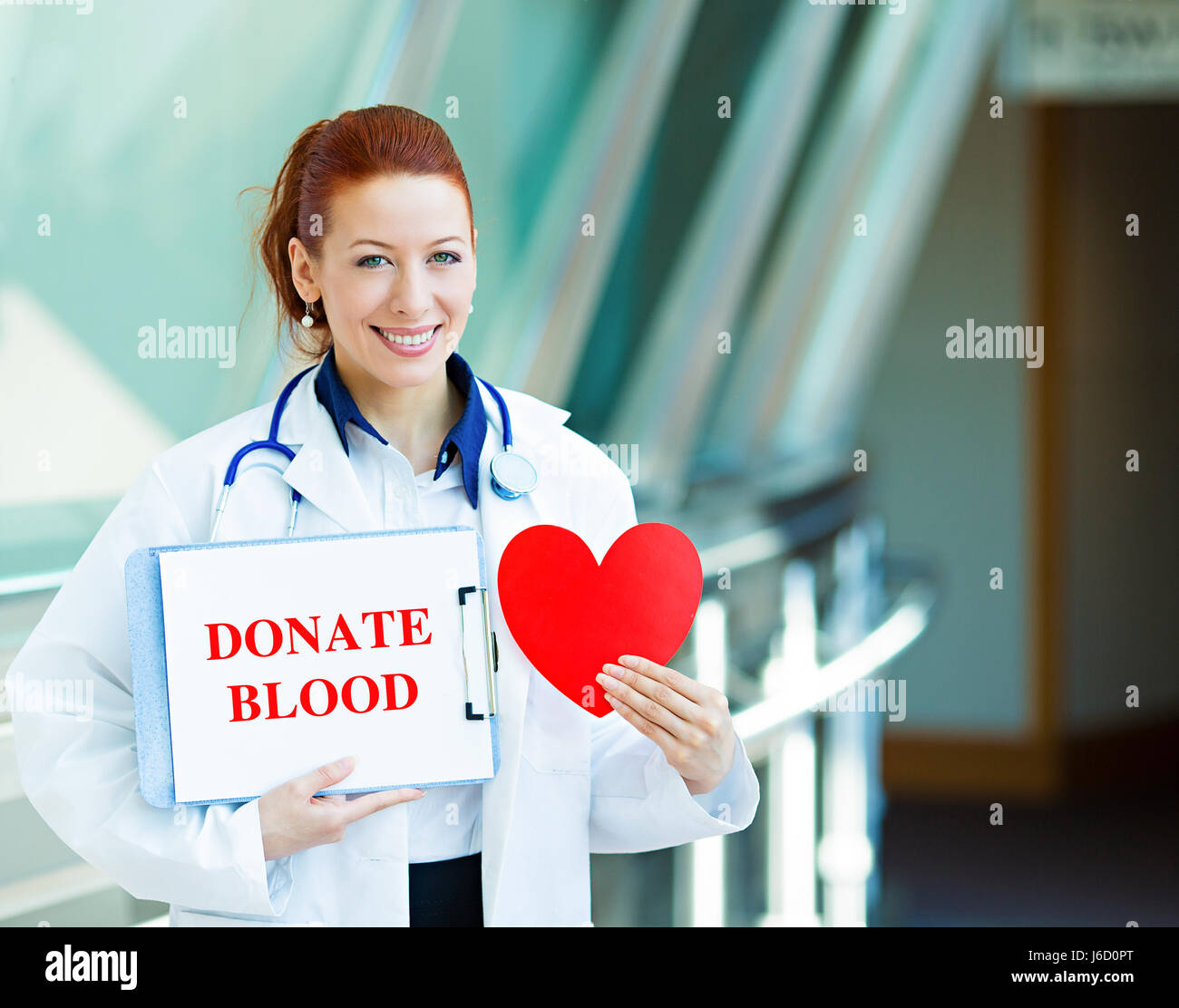 Closeup portrait happy smiling female health care professional woman doctor, transfusion medicine specialist holding - Stock Image
