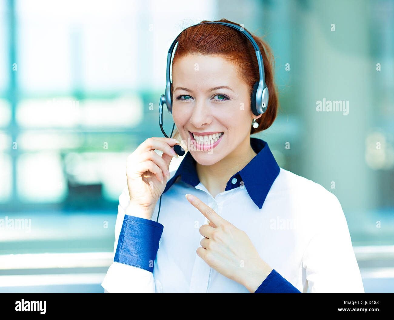 Closeup portrait young happy successful business woman, customer service representative, call centre worker, operator, - Stock Image