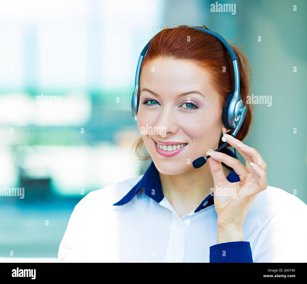 Closeup portrait young happy successful business woman, customer service representative, call centre worker, operator, Stock Photo