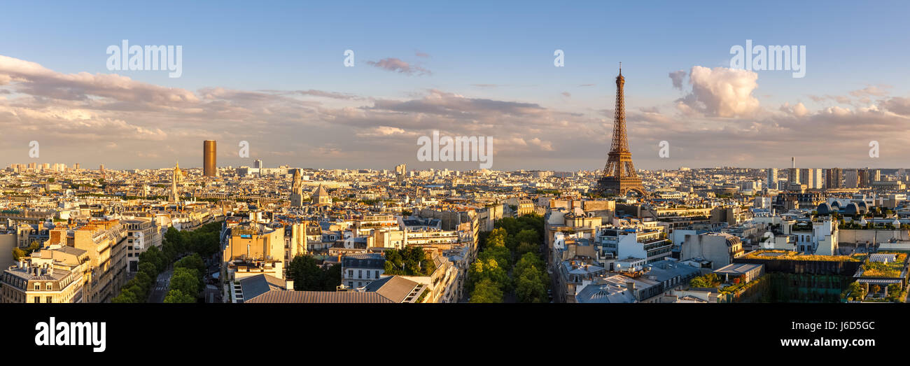 Panoramic summer view of Paris rooftops at sunset with the Eiffel Tower. 16th Arrondissement, Paris, France - Stock Image