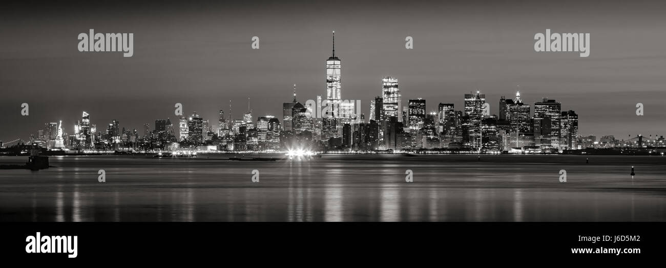 Panoramic view of Lower Manhattan Financial District skyscrapers in Black & White at dawn from New York City - Stock Image