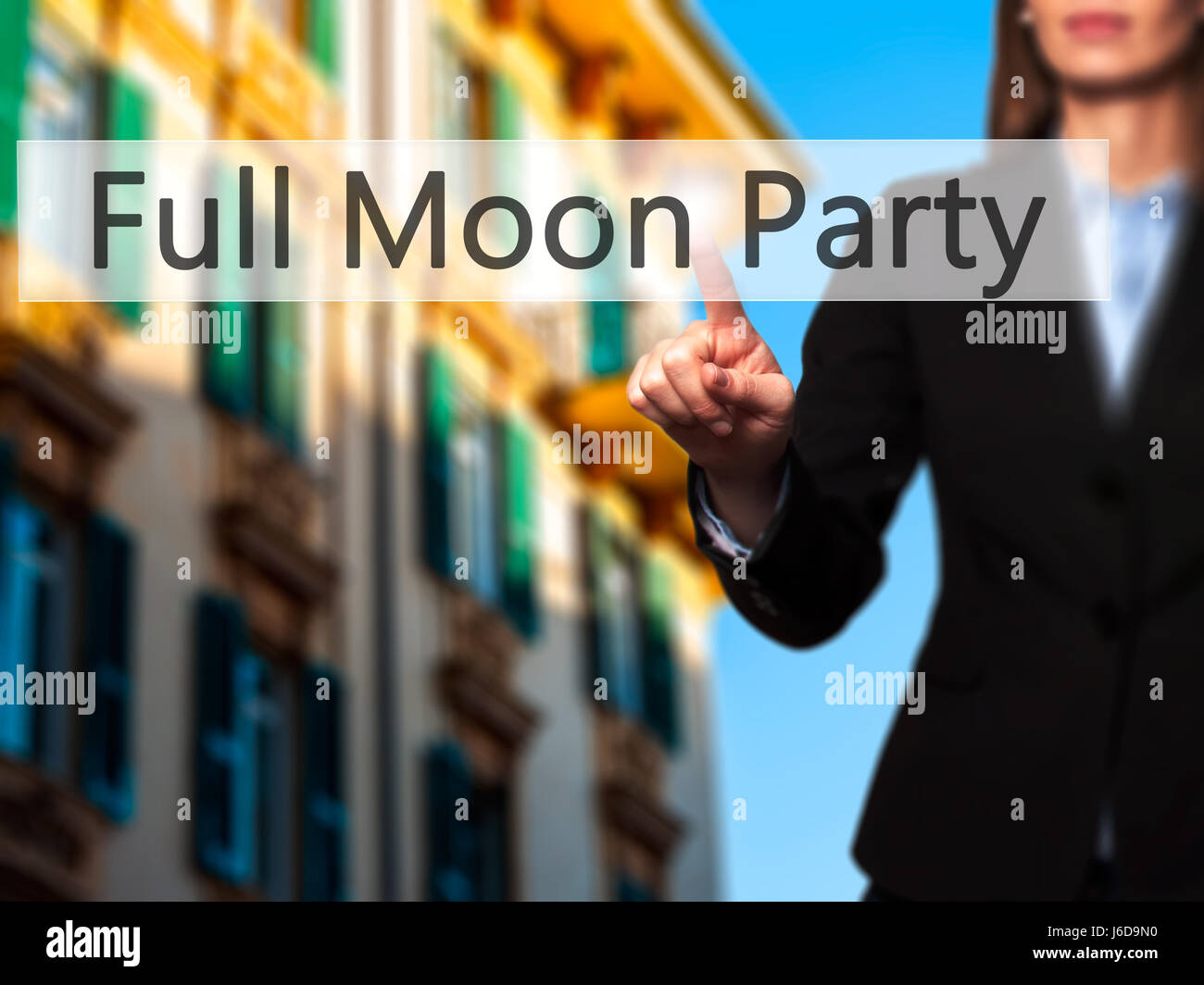 Full Moon Party - Businesswoman hand pressing button on touch screen interface. Business, technology, internet concept. - Stock Image